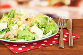 Caesar salad on blue plate, on bright background — Stock Photo