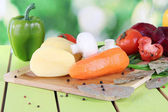 Composition of vegetables on bright background — Stock Photo