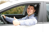 Portrait of young man sitting in the car — Stock Photo
