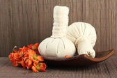 Herbal compress balls for spa treatment on bamboo background — Stock Photo