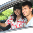 Beautiful happy young couple driving car — Stok fotoğraf