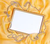 Empty frame on beautiful silk background — Stock Photo
