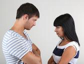 Loving couple quarrel on grey background — Stock Photo