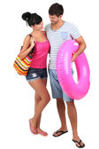 Beautiful loving couple at summer vacation isolated on white — Stock Photo