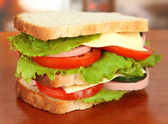 Tasty sandwich on table in cafe — Stock Photo