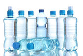 Different water bottles isolated on white — Stock Photo