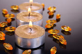Golden candles isolated on black — Stock Photo