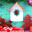 Nesting box  and Christmas decoration on blue background — Stock Photo