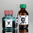 Постер, плакат: Deadly poison in bottles on grey background