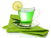 Transparent cup of green tea with lemon on napkin, isolated on white — Stock Photo