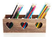 Verschillende potloden in houten kist, geïsoleerd op wit — Stockfoto