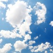Stock Photo: Blue sky background with clouds