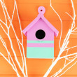 Decorative nesting box with color branches, on color wooden background — Stock Photo #27109085