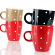 Four cups of polka dot isolated on white — Stock Photo