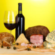 Exquisite still life of wine, cheese and meat products — Stock Photo #27109799