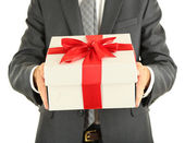 Young businessman present gift box, isolated on white — Stock Photo