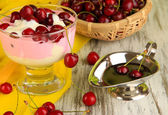 Delicious cherry dessert in glass vase on wooden table close-up — Foto de Stock