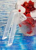 Frozen berries in bucket of ice on color background — Stock Photo