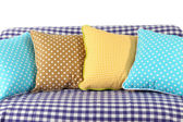 Colorful pillows on couch isolated on white — Stockfoto
