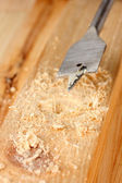 Close-up image of drilling hole on wooden plank — Stock Photo