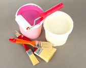 Set for painting: paint pot, brushes, paint-roller on grey background — Stock Photo