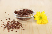 Useful flax seeds on wooden table close-up — Stock Photo