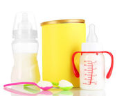 Bottles with milk and food for babies isolated on white — Stock Photo