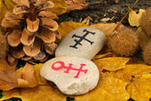 Fortune telling with symbols on stones close up — Stock Photo