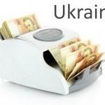 Постер, плакат: Machine for counting money with Ukrainian money isolated on white