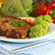 Stock Photo: Piece of fried meat on plate on wooden table close-up