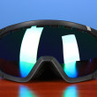 Winter sport glasses, on blue background — Stock Photo