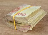 Ukrainian money on wooden background — Stock Photo