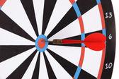 Target with dart close-up — Stock Photo