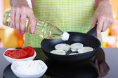 Hands cooking marrows in pan in kitchen — Stock Photo