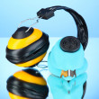 Respirator and headphones on blue background — Stock Photo