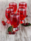Glasses compote on wooden table — Stock Photo