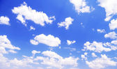 Blue sky background with clouds — Stock Photo