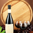 Composition of wine, wooden barrel and grape, on brown background — Stock Photo #27236721
