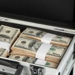Suitcase with 100 dollar bills on grey background — Stock Photo #27236783