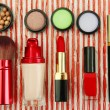 Decorative cosmetics on bright background — Stock Photo