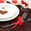 Table setting in honor of Valentine's Day close-up — Stock Photo #27237003