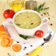 Stock Photo: Nourishing soup in pink pwith ingredients on wooden table close-up