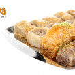 Sweet baklava on tray isolated on white — Stock Photo #27238503