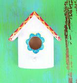 Decorative nesting box on color background — Stock Photo