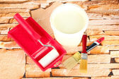 Set for painting: paint pot, brushes, paint-roller on stone background — Stock Photo