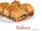 Dulce baklava en placa aislada en blanco — Foto de Stock