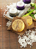 Hand-made soap and sea salt on grey bamboo mat — Foto Stock