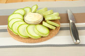 Fresh marrows on cutting board, on color napkin background — Stock Photo