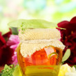 Jar of honey with flowers of lime, acacia, peony on wooden table, on bright background — Stock Photo