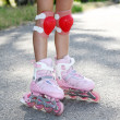 Little girl2s legs in roller skates, close-up — Stock Photo